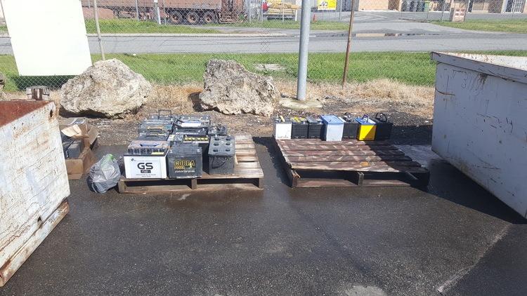 Illegal outdoor storage of used lead acid batteries